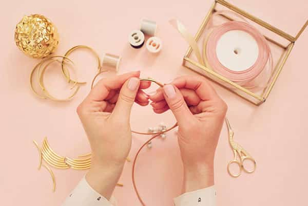 Jewelry Designer Making Personalized Handmade Jewelry at Her Workplace