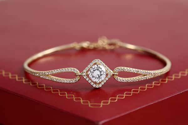 Yellow Gold Diamond Bracelet on a Vintage Red Jewelry Box
