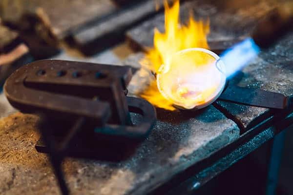 Jeweler Melting and Processing Gold Metal