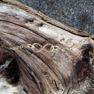 Tiny Infinity Pendant on Wooden Setting