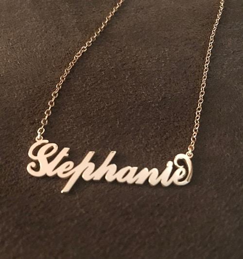 Stephanie's Carrie Name Necklace on a Gray Velvet Setting