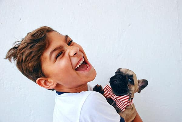 Boy Holding and Sharing Moments With His Pet Dog Friend