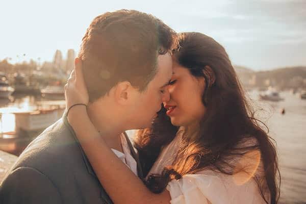 Couple's Portugal Kiss on a Sunny Beach