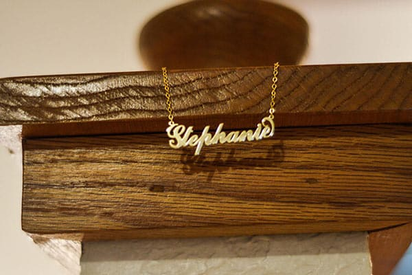 Hanging Stephanie's Carrie Name Necklace for a Desk (14K Yellow Gold Plated)