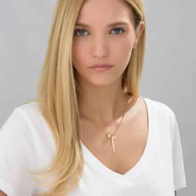 Young Lady Wearing Personalized Vertical Bar Necklace With 3D Heart Charm and Pearl