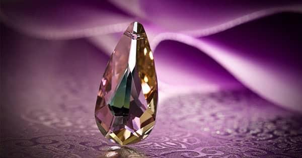 Pear-Shaped Purple Gemstones on a Purple Cloth