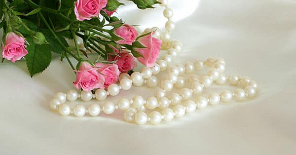 White Gemstone Example: White Pearls With Pink Roses