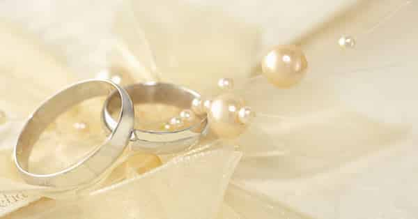 White Gold Wedding Bands on Champagne-Colored Cloth