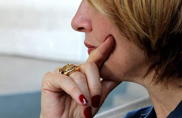 Experienced Company Management Wearing Gold Signet Ring on Her Finger