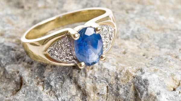 Gold Sapphire Diamond-Cluster Ring on a Rock