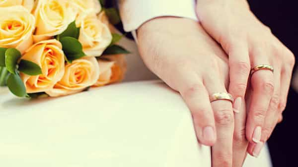 Groom and Bride's Hands With Rose Wedding Rings