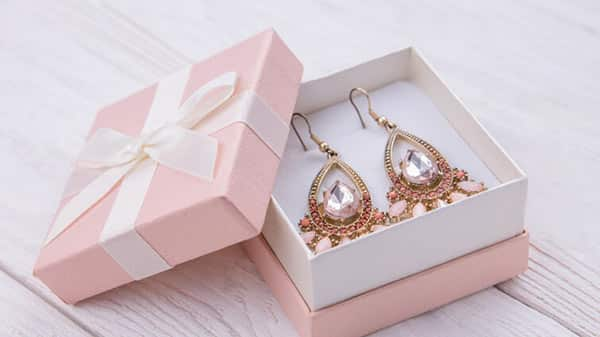Pink Gemstone Pairing: Purple and Pink Gems Earrings in a Jewelry Box