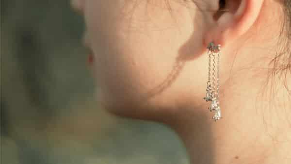Girl Wearing Sterling Silver Dangle Earrings