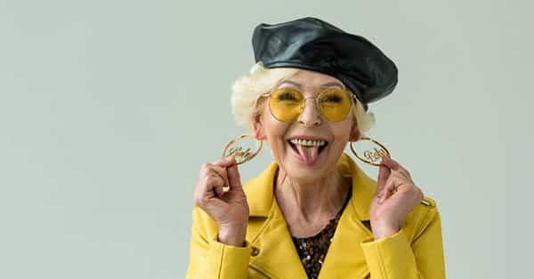 Stylish Elder Woman Wearing Custom Earrings, Laughing With Great Joy