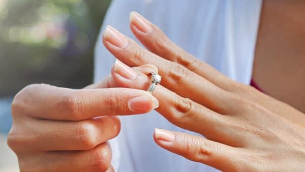 Woman Taking off Her Rhodium-Plating Wedding Ring Before Workout
