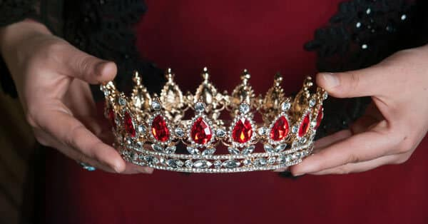 Red Gemstone Jewelry: Lady Holding Red Gem Crown