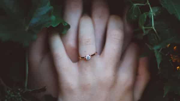 1 Carat Diamond and Couple's Hands