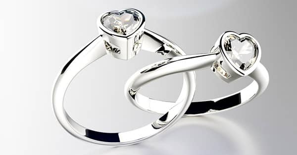 Bezel Setting Rings in Platinum With Heart-Shaped Diamonds