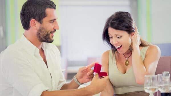 Diamond Carat vs. Cut: A Brilliant Diamond Ring Surprising a Female