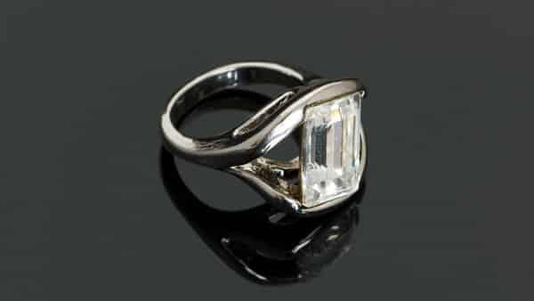 Partial Semi Bezel Ring With Emerald Cut Diamond Stone