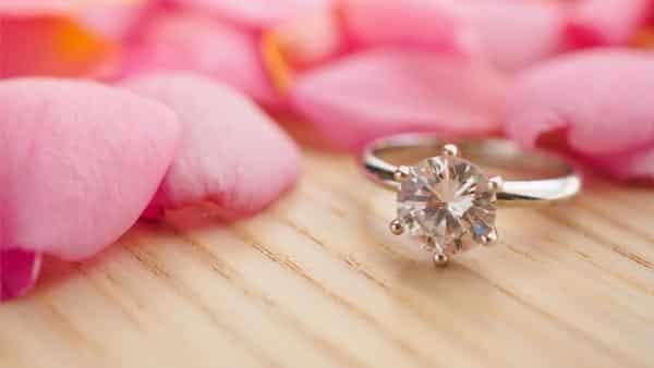 2-Carat Diamond Ring Beside Rose Petals