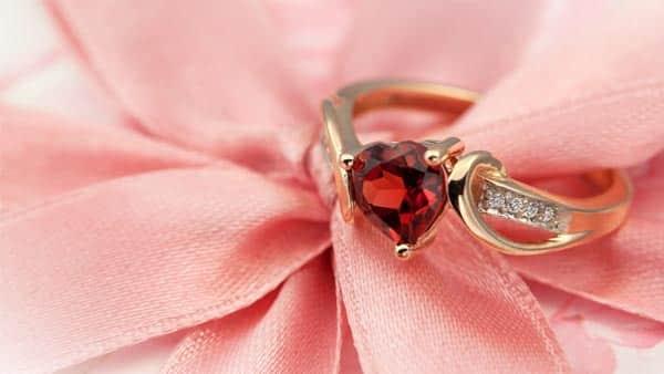 Wearing Garnet Crystal Ring for First Chakra Healing