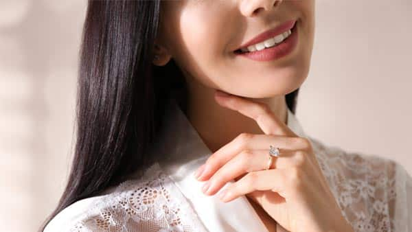 Young Lady Wears Diamond Engagement Ring