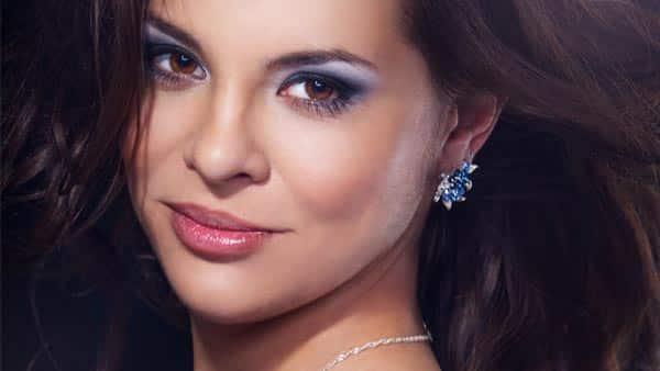 Lady Wearing Blue Diamond Earrings