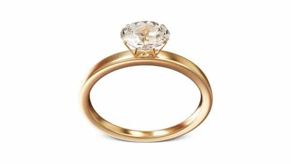 Gold Wedding Ring With Yellowish Diamond