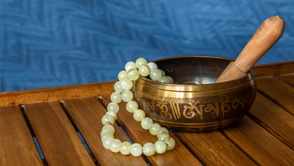 Jade Bead Necklace on a Singing Bowl