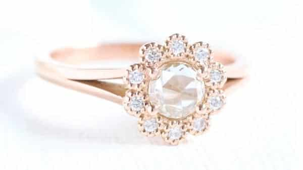 A Rose-Cut Diamond Ring With Modern Brilliant Cut Accents