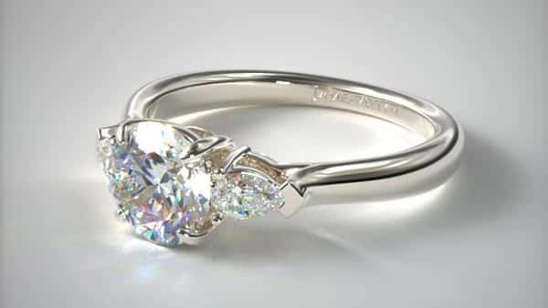 Three-Stone Diamond Ring: Round Cut Center Stone and Pear-Shaped Side Stones